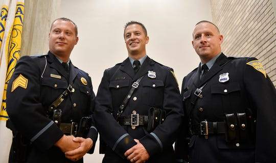 Members of the Vineland Police Department, from left to right, Brian Armstrong, Kevin Vai and James Day, all take part in a promotion ceremony at city hall on Wednesday, August 28, 2019.