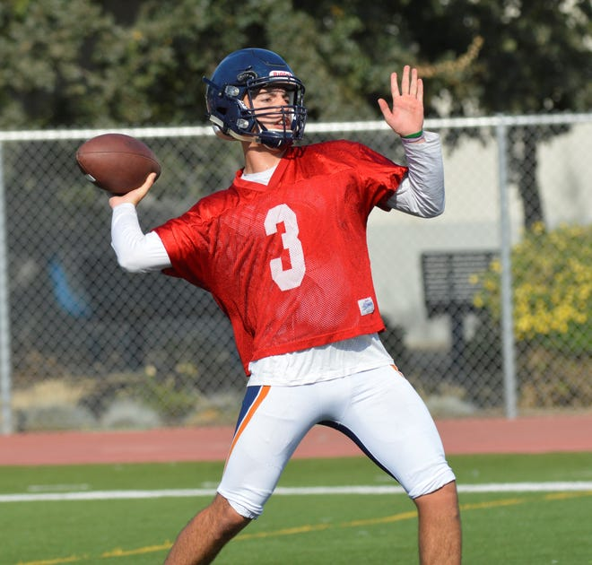 COS QB Gus Villareal throws during a practice in August.