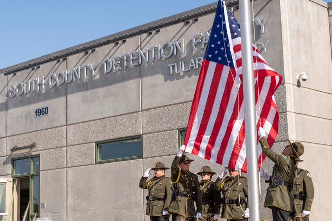 Tulare County Sheriff's Department Honor Guard raises flags during an unveiling of the new South County Detention Facility in Porterville on Wednesday, August 28, 2019.
