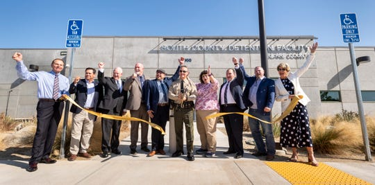 Tulare County Sheriff Mike Boudreaux, center and others celebrate during the unveiling of the new South County Detention Facility in Porterville on Wednesday, August 28, 2019.