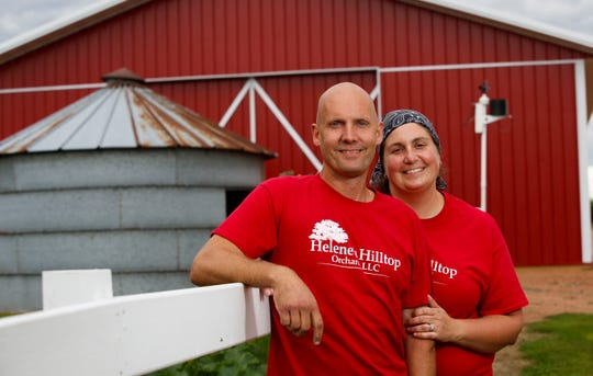 Mark and Olivia Telschow pose for a portrait on Thursday, August 22, 2019, at Helene's Hill Orchard in Merrill, Wis. The couple has owned the former dairy farm, which has been in their family for 100 years, since 2017, and continue finding ways to grow the business.