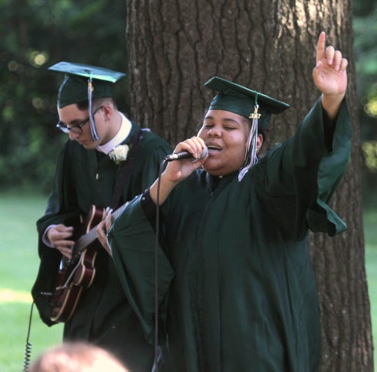From left, Graduates Dakota Scholz and Keana Outlar perform during the Rockland Country Day School graduation in Congers June 15, 2012.