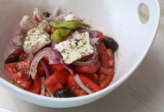 Greek salad with tomatoes, cucumber, onion and feta cheese at Telly's Taverna, an authentic Greek restaurant in Port Chester, Aug. 28, 2019. The family-owned business opened their first location in Astoria in 1990 and brought the same food and ambiance to Westchester this summer.