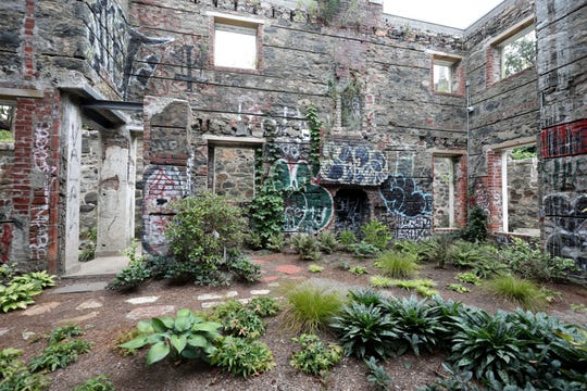 Plants and a walking path are pictured in the Ruin Garden, the old Gate House, at Untermyer Park and Gardens in Yonkers, Aug. 28, 2019.