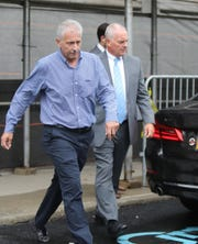 Keith Borge, right, former controller at The College of New Rochelle, exits the Federal Courthouse in White Plains after his sentencing on charges of securities fraud and failure to pay payroll taxes on Wednesday, August 28, 2019.