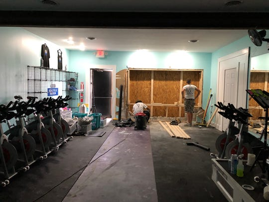 Sea Cycle Indoor's owner Ellen Spell said she'll need to replace part of the floor, front wall and instructor platform after a car crashed into the building Wednesday.