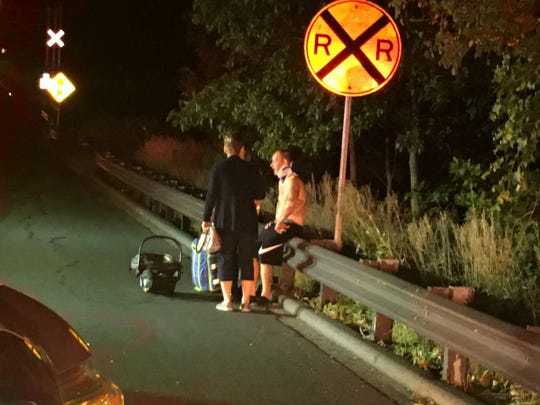 A vehicle went off a bridge on Lancaster Pike Tuesday night and burst into flames. At least two adults were treated by paramedics.