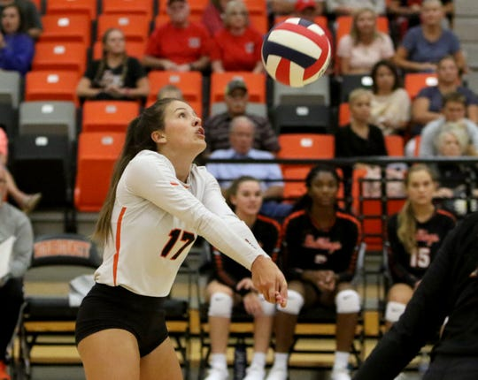 Burkburnett's Ambree Anderle passes in the match against Holliday Tuesday, Aug. 27, 2019, in Burkburnett.