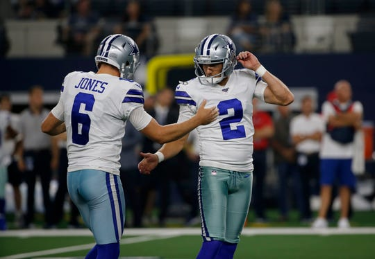 Dallas Cowboys' Chris Jones (6) and Brett Maher (2) celebrate in the first half of a preseason NFL football game against the Houston Texans in Arlington, Texas, Saturday, Aug. 24, 2019. (AP Photo/Michael Ainsworth)