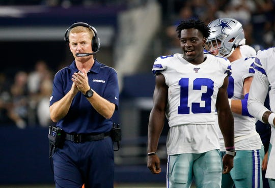 Dallas Cowboys head coach Jason Garrett and wide receiver Michael Gallup (13) walk along the sideline in the second half of a preseason NFL football game against the Houston Texans in Arlington, Texas, Saturday, Aug. 24, 2019. (AP Photo/Ron Jenkins)