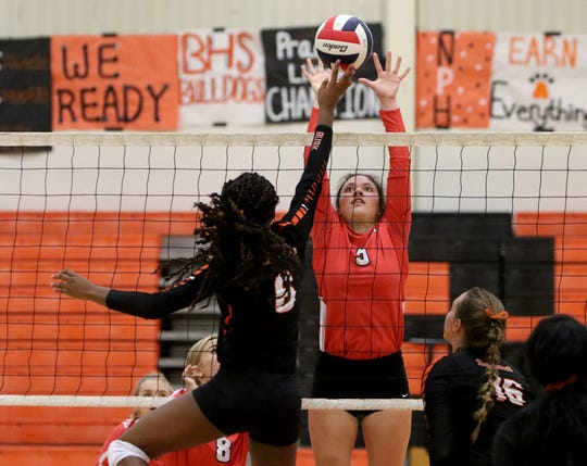 Holliday's Gracie Story jumps to block Burkburnett's Jaliyah Cox Tuesday, Aug. 27, 2019, in Burkburnett.