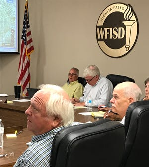 Wichita Falls ISD trustees listen to a presentation from Superintendent Michael Kuhrt on elementary schools during a recent work session at the Education Center.