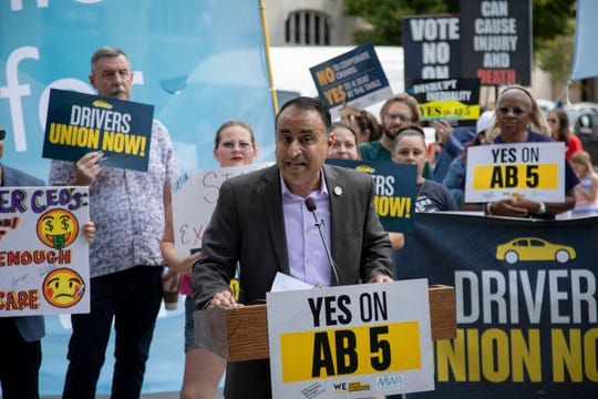 California Assemblyman Ash Kalra, a Democrat from San Jose and chair of the Committee on Labor and Employment, speaks at a rally in support of AB 5 on Wednesday, Aug. 28, in Sacramento, Calif.