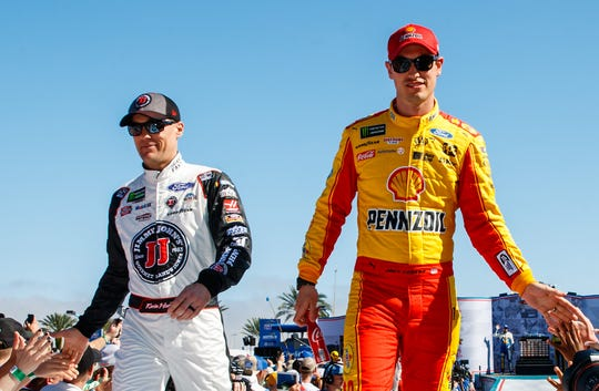 Kevin Harvick, left, and Joey Logano are introduced prior to the 2018 Daytona 500.