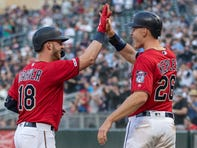Twins catcher Mitch Garver, left, celebrates with right fielder Max Kepler after hitting a two-run home run against the Angels at Target Field.