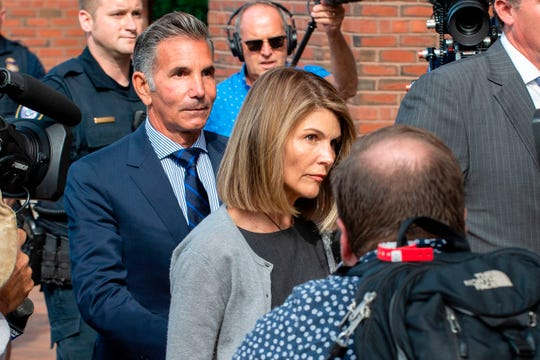Lori Loughlin and husband Mossimo Giannulli exit the Boston Federal Court house after a pre-trial hearing with Magistrate Judge Kelley at the John Joseph Moakley US Courthouse in Boston on August 27, 2019. Loughlin and Giannulli are charged with conspiracy to commit mail and wire fraud and conspiracy to commit money laundering in the college admissions scandal.