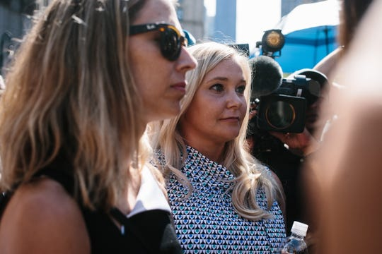 Virginia Giuffre, center, departs court in New York City on Aug. 27, 2019.