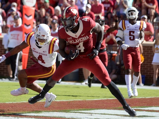 Oklahoma running back Trey Sermon  scores a touchdown during the team's loss to Iowa State in 2017.