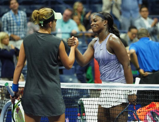 Anna Kalinskaya shakes hands with Sloane Stephens after their match.