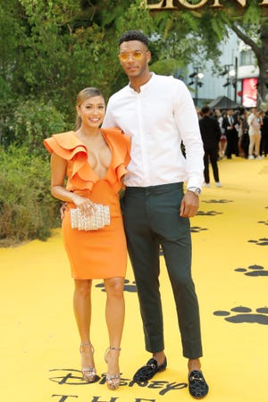 """Kaz Crossley and Theo Campbell at the London premiere of """"The Lion King."""" The couple were in Ibiza recently when someone opened a bottle of champagne near Campbell's face, striking him in the eye with the cork."""