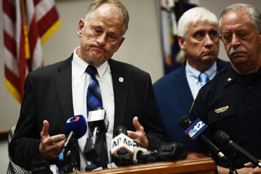 Virginia Beach City Manager Dave Hansen, with Virginia Beach Police Chief James Cervera (R),  speaks to the press on June 1, 2019, in Virginia, Beach, Virginia. Hansen spoke about the May 31 mass shooting.