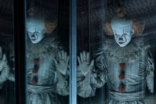 "Pennywise (Bill Skarsgard) creeps out the adult Losers' Club in the horror sequel ""It: Chapter Two."""