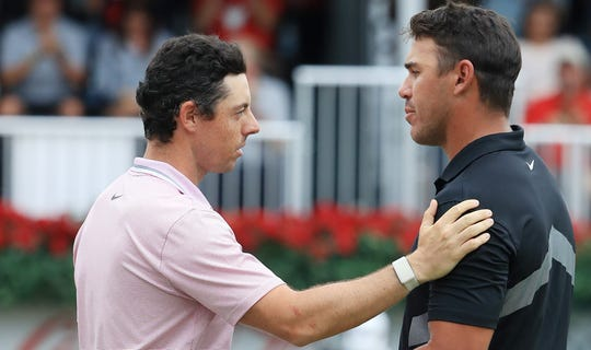 Rory McIlroy, left, won the FedEx Cup and Brooks Koepka finished the year ranked No. 1.