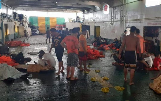 A handout picture made available by Philippine Coast Guard (PCG) shows passengers and coast guard rescuers following a ferry fire off Dapitan city, Zamboanga del Norte province, Philippines, 28 August 2019.