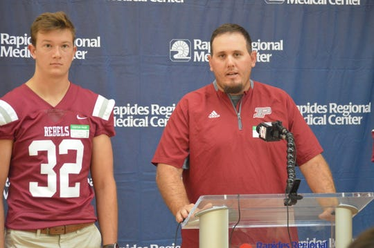 Pineville coach Darin Moore (right) speaks to the media during Wednesday's press conference promoting the Rapides Orthopedic & Sports Medicine Clinic Cenla Jamboree at Rapides Women's and Children's Hospital.