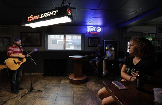 Jacob Fannin, owner of the Dashboard Tea Co., is a songwriter and musician. He's shown here performing at Jack's Apple Pub during 2018's Mile of Music in Appleton.