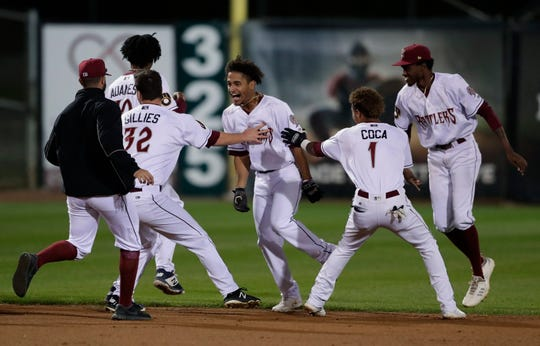 Timber Rattlers center fielder Pablo Abreu, center, is mobbed by teammates after driving in the winning run in the bottom of the ninth inning against Kane County on Aug. 28 at Neuroscience Group Field at Fox Cities Stadium in Grand Chute.