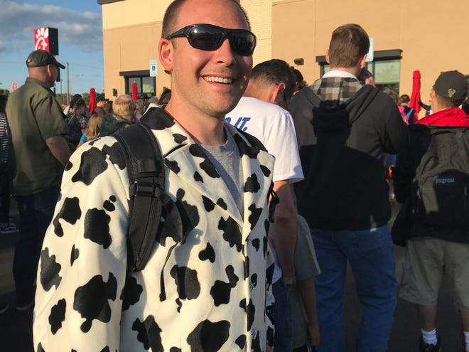 Kevin Lawracy of Neenah came dressed in a cow-print suit to Chick-fil-A's First 100 camp out in Grand Chute Wednesday night. The restaurant opened to the public at 6:30 a.m. Thursday, and saw huge crowds all day.