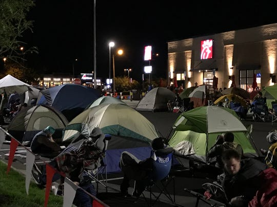 The Buzz: Campers sleep in Chick-fil-A parking lot in Grand
