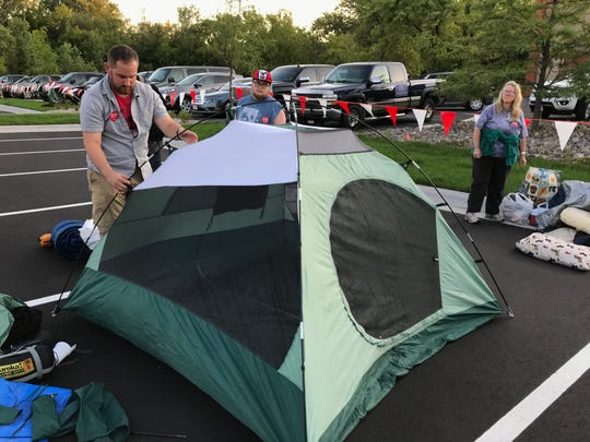 Thomas Kilber of Neenah sets up his tent in the Chick-fil-A parking lot Wednesday night in Grand Chute. He was part of the First 100 camp out before the restaurant's Thursday morning opening.