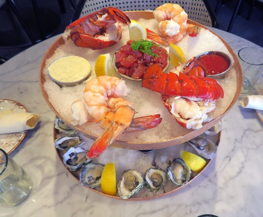 A seafood tower with jumbo shrimp, lobster tail, tuna tartare, and East and West Coast oysters from 100 Ocean at the Wave Resort in Long Branch Tuesday, August 20, 2019.