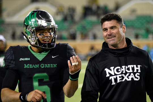 North Texas quarterback Mason Fine (6), shown here with coach Seth Littrell, is a two-time C-USA offensive player of the year and one of nine starters back on the league's highest-scoring offense. The Mean Green, who are favored to win the Conference USA West Division, play Abilene Christian on Saturday in Denton.(Jake King/The Denton Record-Chronicle)