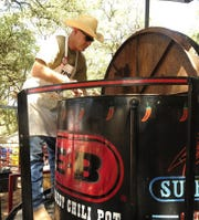 "Brad Birchun, with the Taylor County Sheriff's Department, stirs the ""World's Largest Chili Pot"" during the 34th annual Chili Super Bowl and Cook-off in 2015, in Buffalo Gap."