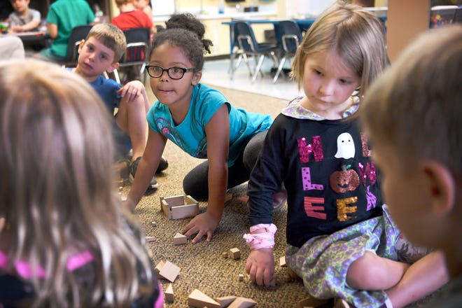 Kindergarten students Sofia Goodson, left, and Tybee Card make things out of blocks in their class at Evergreen Community Charter School on Aug. 27, 2019.