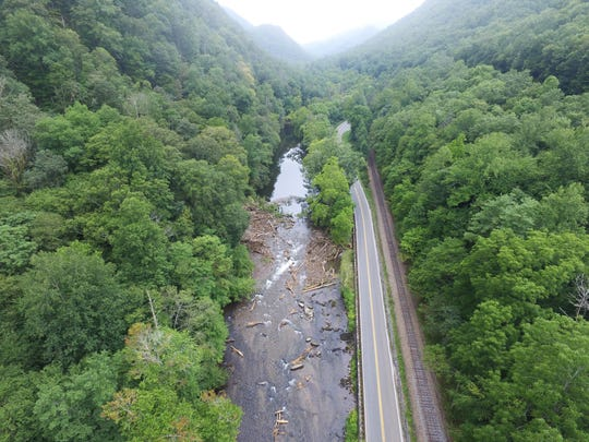 This view of the Nantahala River upstream of Ferebee Park along U.S. 19/74 in the Nantahala Gorge shows how much debris was deposited in the river from an Aug. 25 landslide.