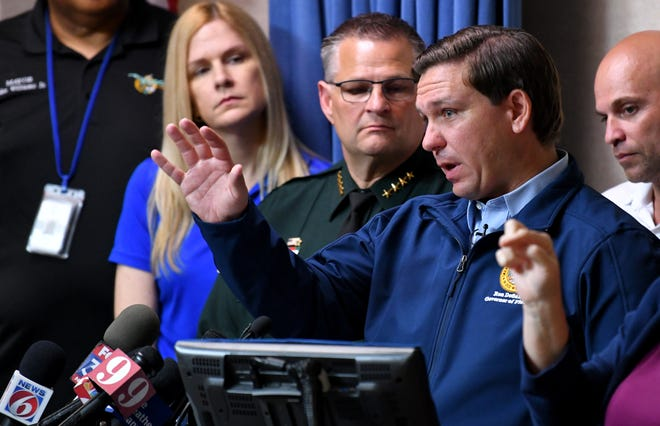 Florida Gov. Ron DeSantis speaks at the Brevard County Emergency Operations Center in Rockledge on Thursday as Hurricane Dorian approaches the state. Several state representatives and other elected officials also attended.