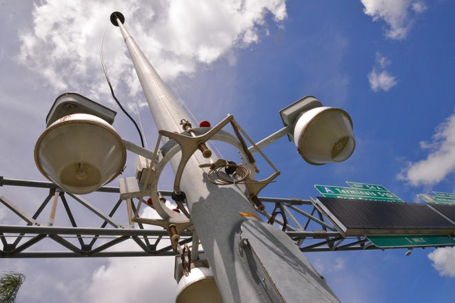 At Port Canaveral on Thursday, maintenance workers lowered all the tall street lights at the port entrance down the poles to about 6 feet off the ground to protect them from high winds expected from the Hurricane Dorian.