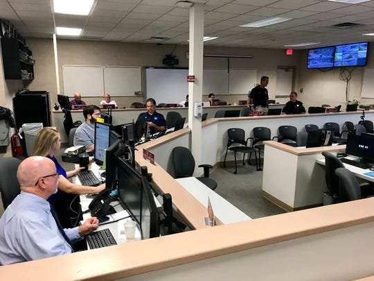 Brevard County Communications Director Don Walker, foreground, and other officials were at the Brevard County Emergency Operations Center in Rockledge on Thursday, preparing for Hurricane Dorian.