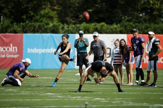 Carli Lloyd attempts to kick a field goal after the Philadelphia Eagles and the Baltimore Ravens held a joint NFL football practice in Philadelphia, Tuesday, Aug. 20, 2019.