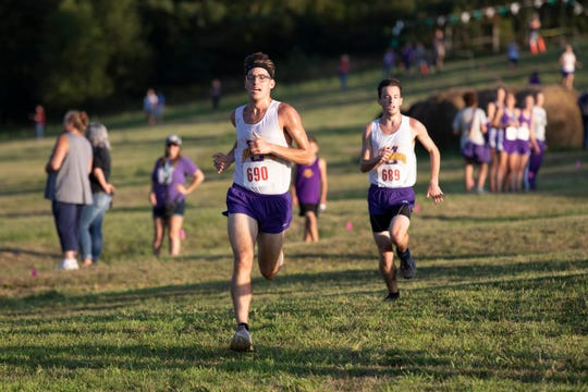 Robert Immell competes at the Huntington Invitational at Hopkins Farm in Huntington Township as the Unioto boys team took first place with an average time of 18:00.85 and Unioto's Corey Schobelock took first place with a time of 17:44.15.