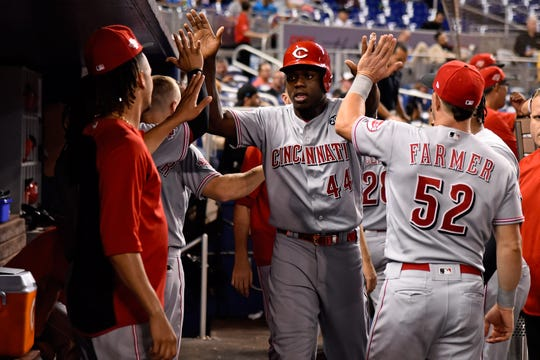 Aug 28, 2019; Miami, FL, USA; Cincinnati Reds right fielder Aristides Aquino (44) celebrates after scoring a run in the fourth inning against the Miami Marlins at Marlins Park.
