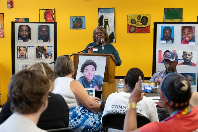 Family members of Eric Shields, who was shot and killed in the West End, speak at the Neighborhoods Unite meeting at the West End YMCA in Cincinnati, Ohio on Wednesday, Aug. 28, 2019.  The meeting brought together community members to discuss recent gun violence in the area.