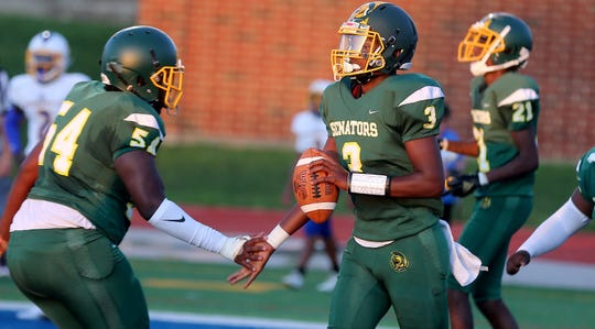 Taft quarterback Robert Brazziel (3) and Mykavien Stephens celebrate after a touchdown, during the game against Northwest on Wednesday, Aug. 28, 2019.
