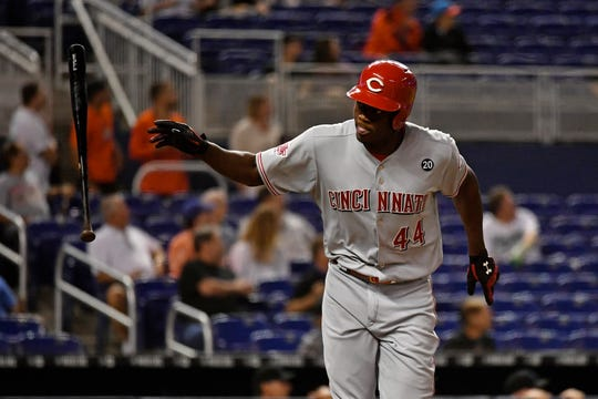 Aug 28, 2019; Miami, FL, USA; Cincinnati Reds right fielder Aristides Aquino (44) tosses his bat after connecting for a three run home run in the first inning against the Miami Marlins at Marlins Park.