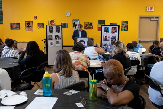 Participants observe a moment of silence for victims of gun violence at the Neighborhoods Unite meeting at the West End YMCA in Cincinnati, Ohio on Wednesday, Aug. 28, 2019.  The meeting brought together community members to discuss recent gun violence in the area.
