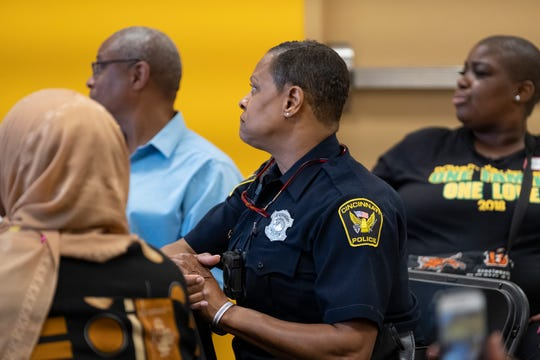 Community members gather at the Neighborhoods Unite meeting at the West End YMCA in Cincinnati, Ohio on Wednesday, Aug. 28, 2019.  The meeting brought together community members to discuss recent gun violence in the area.